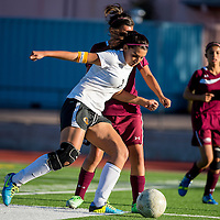100813      Brian Leddy<br /> Gallup Bengal Alisha Campos (7) keeps the ball away from a Belen Eagle defender during Tuesday's game at Public School Stadium.