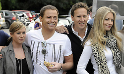 ©  licensed to London News Pictures. 10/06/2011. Cobham, UK. L to R  Brooke Kinsella, Joe Swash and Chesney Hawkes at the start line of  the The Supercar Challenge. Several cars worth more than £2 million in total left from the picturesque Leather Bottle pub, Cobham, for this third annual event which will see contestants take part in a series of challenges on the 1000 mile four day event. See special instructions for details. Picture credit should read Grant Falvey/LNP