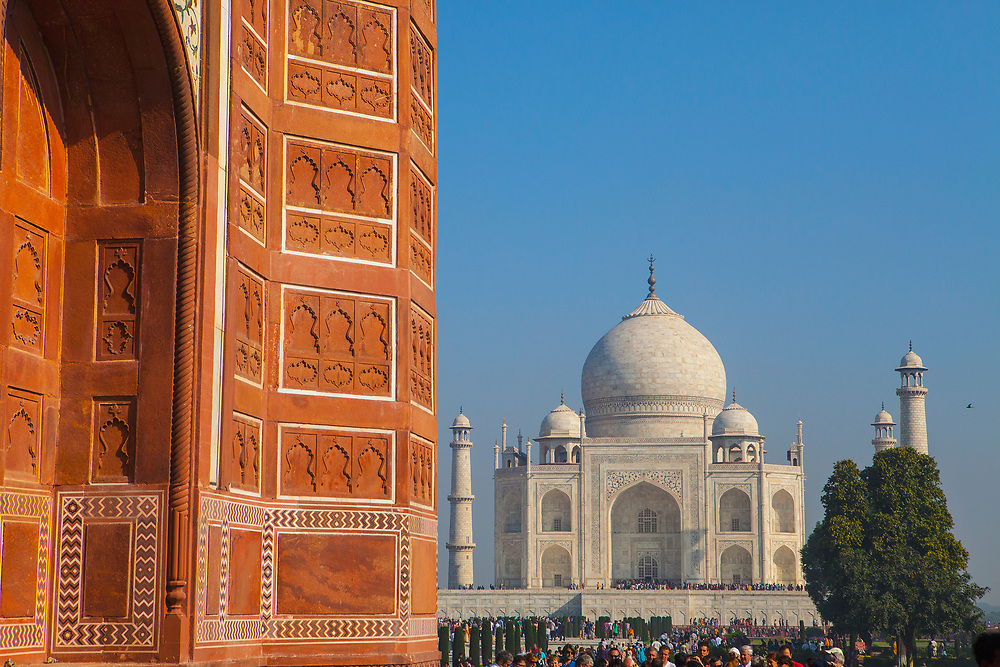 Side of one of the entrance buildings with the Taj Mahal in the distance