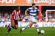 Queens Park Rangers Midfielder Massimo Luongo (21) and Brentford Midfielder Romaine Sawyers (19) battle for the ball during the EFL Sky Bet Championship match between Brentford and Queens Park Rangers at Griffin Park, London, England on 21 April 2018. Picture by Stephen Wright.