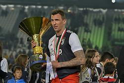 May 19, 2019 - Turin, Turin, Italy - Mario Mandzukic of Juventus FC lifts the trophy of Scudetto  2018-2019 at Allianz Stadium, Turin  (Credit Image: © Antonio Polia/Pacific Press via ZUMA Wire)
