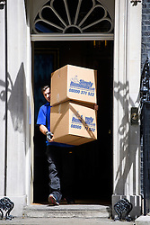 © Licensed to London News Pictures. 16/07/2016. London, UK. Boxes coming out of number 10.  Removal men begin to take items from numbers 10 and 11 at Downing Street at the end of the week that saw Prime Minister David Cameron leave and Theresa May arrive. Photo credit: Ben Cawthra/LNP