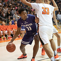 Ro Morgan (11) of Clovis dribbles near the baseline with heavy defense from Josh Lynch (33) of Gallup during the Gallup Invitational held at Gallup High School. Clovis won 64-53.