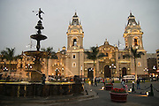 View of the Cathedral from the fountain in the center of the Plaza de Armas in Lima, Peru.