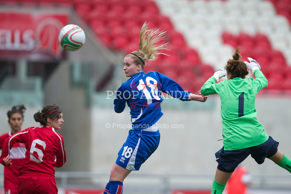 LLANELLI, WALES - Thursday, March 31, 2011: Iceland's Berglind Bjorg Thorvaldsdottir beats Turkey's goalkeeper Go?kc?em Elmira Can to score the opening goal during the UEFA European Women's Under-19 Championship Second Qualifying Round (Group 3) match at Parc Y Scarlets. (Photo by David Rawcliffe/Propaganda)