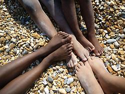Children's feet at the seaside UK