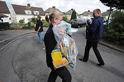 © Licensed to London News Pictures. 12/09/2013. POlice removing evidence from the property in evidence bags. Police Raid a property in Stone, Dartford in connection with Claire Tiltman MURDER 20 YEARS AGO.  Miss Tiltman was stabbed to death in an alleyway off the A226 London Road in Greenhithe, four days after her 16th birthday in 1993.  Photo credit :Grant Falvey/LNP