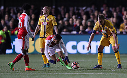 Arsenal's Alexis Sanchez is sent to the ground from a challenge by Sutton's Jamie Collins during the Emirates FA Cup, Fifth Round match at Gander Green Lane, London.
