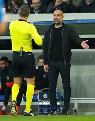 Manchester City manager Pep Guardiola speaks with referee Damir Skomina