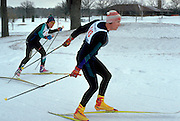 Cross country skiers ages 55 and 35 racing for finish line.  St Paul  Minnesota USA