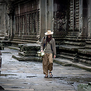 Man walking in inner temple of Angkor Wat (Siem Reap, Cambodia - Oct. 2008) (Image ID: 081024-0733282a)