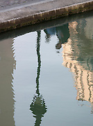 Reflection in the water of the Canal Saint Martin, Paris, France
