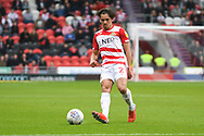 Niall Mason of Doncaster Rovers (2) passes the ball forward during the EFL Sky Bet League 1 match between Doncaster Rovers and Gillingham at the Keepmoat Stadium, Doncaster, England on 20 October 2018.