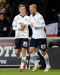 Bolton Wanderers' Eidur Gudjohnsen is congratulated by team mate Josh Vela after scoring the first goal - Photo mandatory by-line: Richard Martin Roberts/JMP - Mobile: 07966 386802 - 04/02/2015 - SPORT - Football - Bolton - Macron Stadium - Bolton Wanderers v Liverpool - FA Cup - Fourth Round
