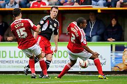 Swindon Defender Darren Ward (ENG) passes past Swindon Defender Nathan Thompson (ENG) during the first half of the match - Photo mandatory by-line: Rogan Thomson/JMP - Tel: 07966 386802 - 21/09/2013 - SPORT - FOOTBALL - County Ground, Swindon - Swindon Town v Bristol City - Sky Bet League 1.