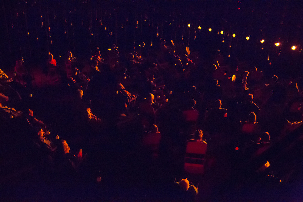 """The audience listens in rapt attention to Samuel Beckett's radio play """"All That Fall."""""""