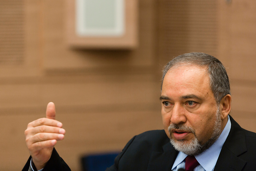 Israel's Foreign Minister, Avigdor Lieberman, gestures as he speaks, during a session of the Foreign Affairs and Defense Committee at the Knesset, Israel's parliament in Jerusalem, on August 4, 2014.