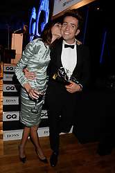 Left to right, ALEXA CHUNG and NICK GRIMSHAW winner of the Radio Personality of the Year Award at the GQ Men of The Year Awards 2013 in association with Hugo Boss held at the Royal Opera House, London on 3rd September 2013.