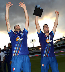 Gloucestershire's David Payne and Gloucestershire's Benny Howell celebrate with The Royal London One Day Cup Trophy - Mandatory byline: Robbie Stephenson/JMP - 07966 386802 - 19/09/2015 - Cricket - Lord's Cricket Ground - London, England - Gloucestershire CCC v Surrey CCC - Royal London One-Day Cup Final