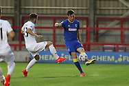 AFC Wimbledon defender Sean Kelly (22) clears the danger during the EFL Trophy match between AFC Wimbledon and U23 Swansea City at the Cherry Red Records Stadium, Kingston, England on 30 August 2016. Photo by Stuart Butcher.