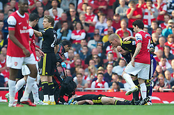 17.04.2011, Emirates Stadium, London, ENG, PL, Arsenal FC vs Liverpool FC, im Bild Liverpool's Jamie Carragher is treated for a serious injury as he lies unconscious during the Premiership match against Arsenal at the Emirates Stadium, EXPA Pictures © 2011, PhotoCredit: EXPA/ Propaganda/ D. Rawcliffe *** ATTENTION *** UK OUT!