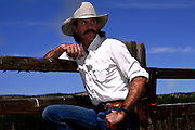 Ricky Nielson, cowboy leaning on fence