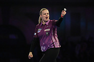 Anastasia Dobromyslova throwing the double to win the first leg of the match, and her first ever leg in the PDC World Championships, and celebrating, during the World Championship Darts 2018 at Alexandra Palace, London, United Kingdom on 17 December 2018.