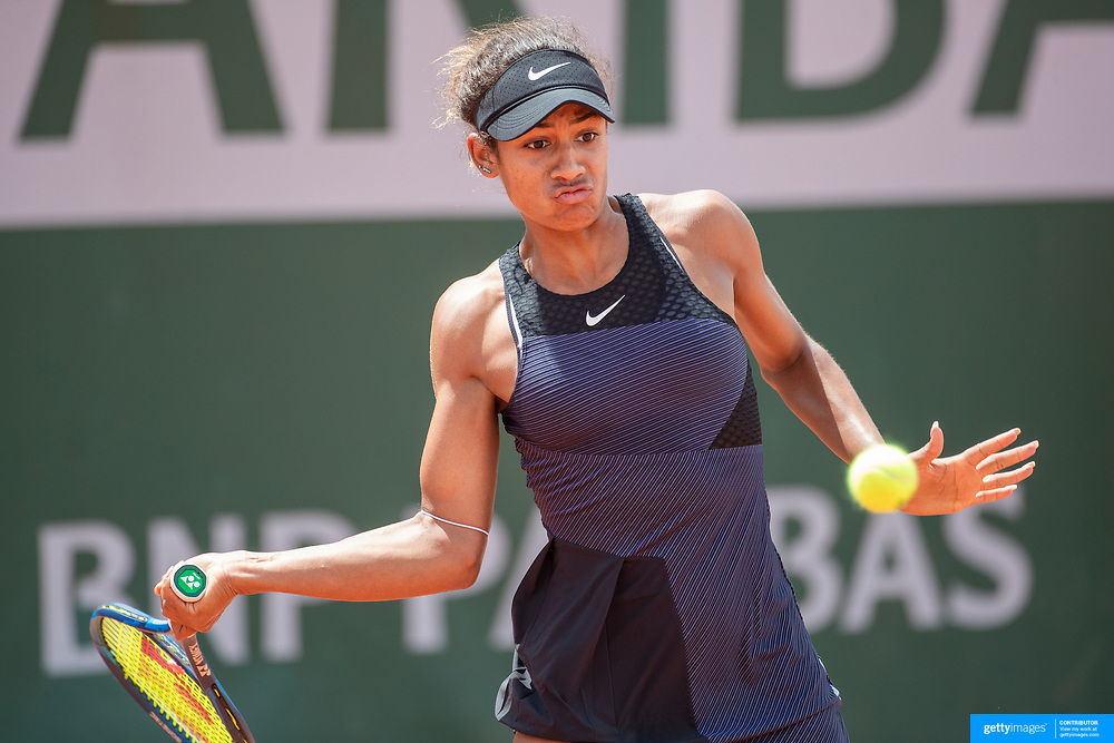 PARIS, FRANCE May 25.  Whitney Osuigwe of the United States in action against Asia Muhammad of the United States on the second day of the qualifying tournament at the 2021 French Open Tennis Tournament at Roland Garros on May 25th 2021 in Paris, France. (Photo by Tim Clayton/Corbis via Getty Images)