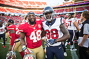 San Francisco 49ers linebacker Wynton McManis (48) and Houston Texans wide receiver Tevin Jones (88) pose for a photo after a preseason game at Levi's Stadium in Santa Clara, Calif., on August 14, 2016. (Stan Olszewski/Special to S.F. Examiner)