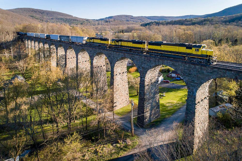New York, Susquehanna and Western train SU-100 crosses historic Starrucca Viaduct on May 13, 2020.