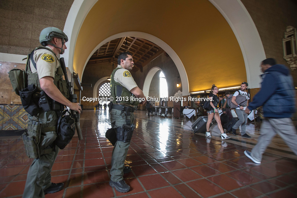 Police officers  keep guard at Union Station after security was increased following mutiple expolsions during the 117th Boston Marathon on April 15, 2013 in Los Angeles, California. California emergency management officials activated a statewide threath assessement system after the explosions. (Photo by Ringo Chiu/PHOTOFORMULA.com).