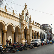 One of the streets lining Parque Central, with city hall at left. Parque Central is the main square and the historic heart of Granada, Nicaragua.