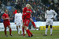 Photo. Andrew Unwin.<br /> Bolton Wanderers v Liverpool, Barclaycard Premier league, Reebok Stadium, Bolton 07/02/2004.<br /> Liverpool's Sami Hyypia (c) is congratulated by Anthony Le Tallec as Bolton's Bruno Ngotty (r) looks upset as Livepool equalise.