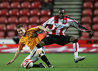 Photo: Lee Earle/Sportsbeat Images.<br /> Southampton v Hull City. Coca Cola Championship. 08/12/2007. Hull's Andy Dawson (L) battles with Stern John.