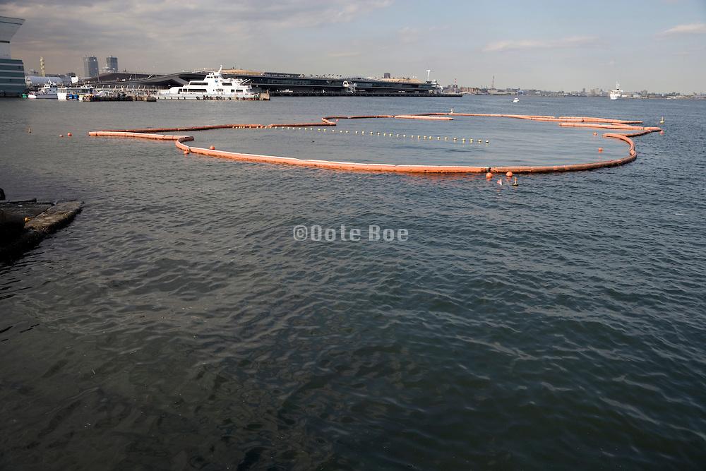 floating barrier in harbor Yokohama Japan