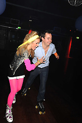EVY LANGTON and JAMIE MURRAY-WELLS a at a Roller Disco in aid of TomÕs Ward at the ChildrenÕs Hospital in Oxford and the charity Place2Be, held at The Renaissance Rooms, London SW8 on the 17th September 2008.<br /> EVY LANGTON and JAMIE MURRAY-WELLS a at a Roller Disco in aid of Tom's Ward at the Children's Hospital in Oxford and the charity Place2Be, held at The Renaissance Rooms, London SW8 on the 17th September 2008.