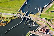 Nederland, Groningen, Gemeente Marne, 04-11-2018; Zoutkamp, voormalige vissersdorp aan de Lauwerszee, nu Lauwersmeer. Bekend van het vissen op en verwerken van garnalen (firma Heiploeg). Het Reitdiep gaat over in Zoutlamperril, richting Lauwersmeer.<br /> Former fishing village on the Lauwerszee.<br /> luchtfoto (toeslag op standaard tarieven);<br /> aerial photo (additional fee required);<br /> copyright © foto/photo Siebe Swart