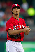 ARLINGTON, TX - JULY 09:  Yu Darvish #11 of the Texas Rangers looks on during the first inning against the Houston Astros on July 9, 2014 at Globe Life Park in Arlington in Arlington, Texas.  (Photo by Cooper Neill/Getty Images) *** Local Caption *** Yu Darvish