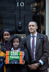 """© Licensed to London News Pictures. 29/11/2016. London, UK. Helawit Hailemariam, Menabe Andargachew, Clive Lewis MP [Left to Right] bring a petition to Downing Street calling on the Prime Minister to seek the release of British man Andargachew """"Andy"""" Tsege, who is in his sixties, who is in prison in Ethiopia under the shadow of a death sentence. Andargachew Tsegehas been detained in the country since he was removed from an airport in Yemen in June 2014. The father-of-three, who fled the country in the 1970s and sought asylum in the UK in 1979, had been a prominent critic of Ethiopia's ruling party. Photo credit : Tom Nicholson/LNP"""