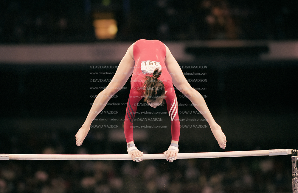 SYDNEY - SEPTEMBER 16:  Amy Chow of the United States competes on the uneven bars during the Women's Gymnastics event of the Olympic Games on September 16, 2000 in Sydney, Australia.  (Photo by David Madison/Getty Images)
