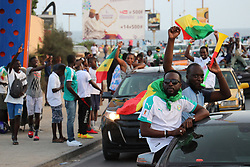 DAKAR, SENEGAL - JULY 14: Senegalese people celebrate their team's final match victory after the 2019 Africa Cup of Nations semi-final match between Senegal and Tunisia on July 14, 2019 in Dakar, Senegal. Tunisia's own goal guides Senegal to the final. Alaattin Dogru  (Credit Image: RealTime Images)