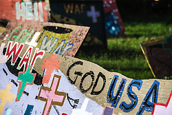 Painted plywood of god, war, country.  Heidelberg Project, Detroit, Michigan.  The Heidelberg Project is a grass roots project started by artist Tyree Guyton that uses art to help revitalize the embattled neighborhood.  Each year, over 275,000 people visit the project .  For more information, go to www.heidelberg.org