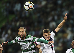 October 22, 2017 - Lisbon, Portugal - Sporting's forward Bas Dost (L) vies with Chaves's defender Maras during the Portuguese League  football match between Sporting CP and Chaves at Jose Alvalade  Stadium in Lisbon on October 22, 2017. (Credit Image: © Carlos Costa/NurPhoto via ZUMA Press)