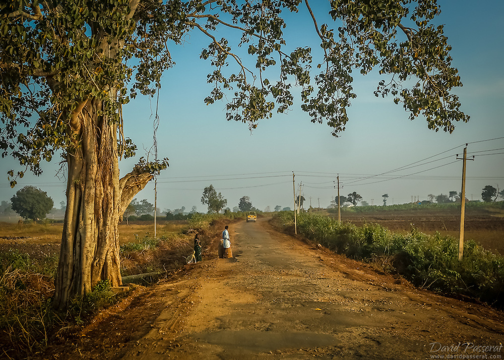 In the outskirts of Mysore, these residents seem to be waiting for this approaching bus.
