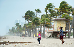 Two children play along the beach in heavy winds in anticipation for Hurricane Irma Saturday, September 9, 2017 in Hollywood, FL, USA. Photo by Paul Chiasson/CP/ABACAPRESS.COM