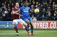 AFC Wimbledon defender Deji Oshilaja (4) battles for possession with Northampton Town midfielder John-Joe O'Toole (21) during the EFL Sky Bet League 1 match between AFC Wimbledon and Northampton Town at the Cherry Red Records Stadium, Kingston, England on 10 February 2018. Picture by Matthew Redman.