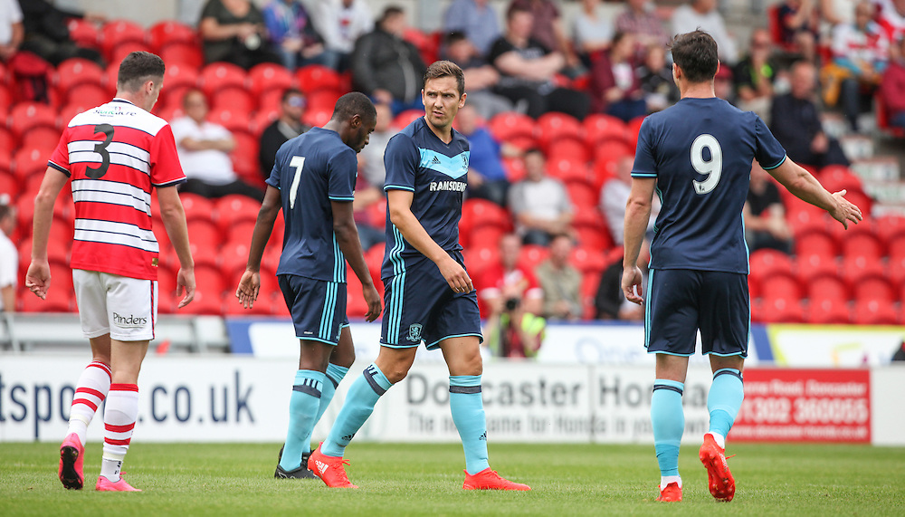 Middlesbrough's Stewart Downing commiserates with Doncaster's Tyler Garratt after he opened the scoring<br /> <br /> Photographer Alex Dodd/CameraSport<br /> <br /> Football - Pre-Season Friendly - Doncaster Rovers v Middlesbrough - Saturday 16 July 2017 - Keepmoat Stadium - Doncaster<br /> <br /> World Copyright © 2016 CameraSport. All rights reserved. 43 Linden Ave. Countesthorpe. Leicester. England. LE8 5PG - Tel: +44 (0) 116 277 4147 - admin@camerasport.com - www.camerasport.com
