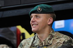 A royal marines commando enjoys watching the wheelchair basketball - Photo mandatory by-line: Dougie Allward/JMP - Mobile: 07966 386802 - 12/09/2014 - The Invictus Games - Day 2 - Wheelchair Rugby - London - Copper Box Arena