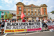 People carrying banners, placards and flags are protesting against police brutality in front of Tottenham Police Station in London on Saturday, Aug 8, 2020. Black Lives Matter enters the 11th weekend of continuous demonstrations against racial injustice in Britain. <br /> Anger against systemic levels of institutional racism have raged and continued throughout the United States, Britain and worldwide; sparked by the death of George Floyd who died on May 25 after he was restrained by Minneapolis police in the United States. (VXP Photo/ Vudi Xhymshiti)