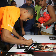 KISSIMMEE, FL - OCTOBER 05: Puerto Rican boxer Felix Verdejo signs autographs during his media workout event at the Kissimmee Boxing Gym on October 4, 2015 in Kissimmee, Florida. Verdejo is returning from a hand injury and announced his next fight will take place in Kissimmee on October 31. (Photo by Alex Menendez/Getty Images) *** Local Caption *** Felix Verdejo